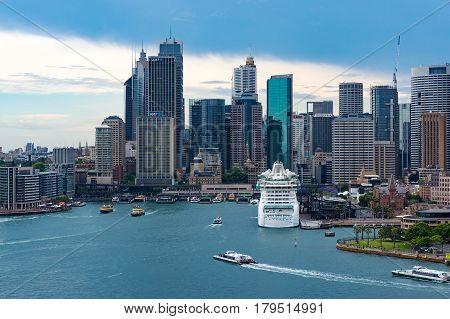 Sydney Cbd Skyline With Radiance Of Seas Cruise Liner At Sydney Harbour