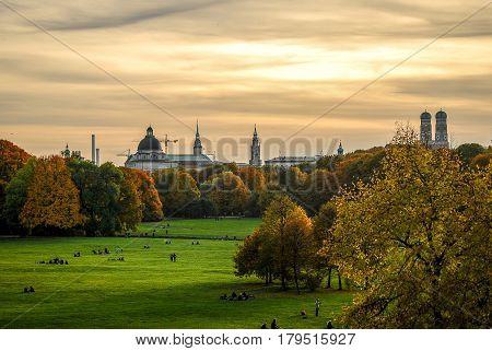 Munich,Germany- October 24,2015: Families stroll in the Englischer Garten park in a warm autumn afternoon