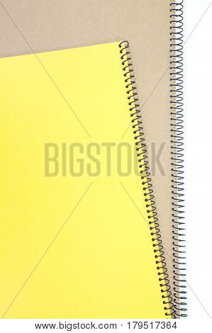 Yellow note book cover and brown note book on white background