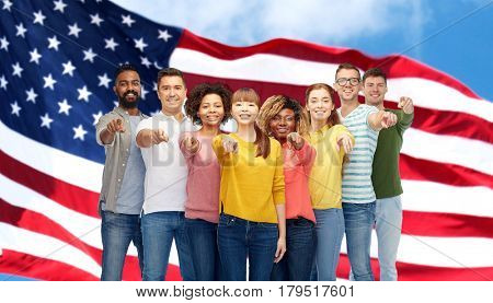 diversity, immigration and people concept - international group of happy smiling men and women pointing finger on you over american flag background
