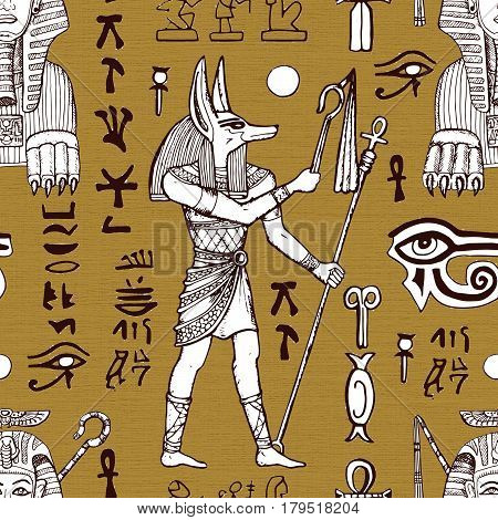 Seamless textured background with Anubis, Sphinx and ancient Egyptian symbols. May be used as wrapping paper, textile design
