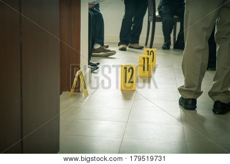 evidence marker with law enforcement and forensic team background in cinematic tone