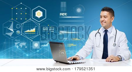 medicine, healthcare, technology and people concept - smiling male doctor with laptop over blue background and virtual charts