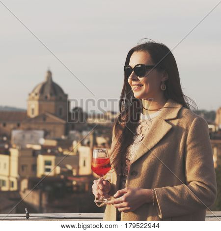 Young Woman Standing With Traditional Italian Alcohol Drink Spritz Aperol On The Terrace With Great