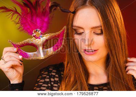Woman Holds Carnival Mask Closeup