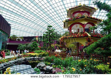 Singapore, Singapore - February 12, 2017: People walk in the Gardens by the Bay Flower Dome pavillion on February day in Singapore.