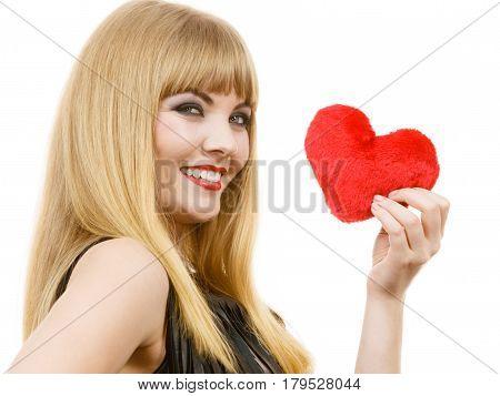 Woman elegant blonde long hair girl dark makeup red lipstick holding red heart love symbol flirting studio shot on white. Valentines day happiness concept