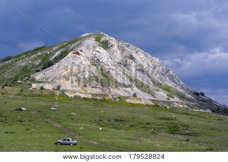 Beautiful summer landscape with high mountain and sky