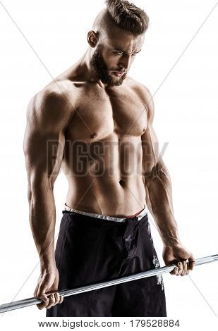 Guy with athletic body doing exercises with barbell isolated on white background. Strength and motivation.