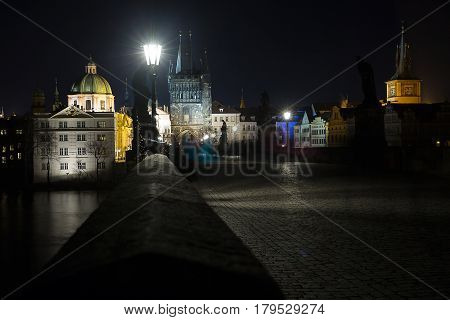 Beautiful view of the evening Charles Bridge in Prague and the Vltava River.