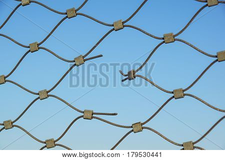 Metal wire fence protection chainlink background . hole