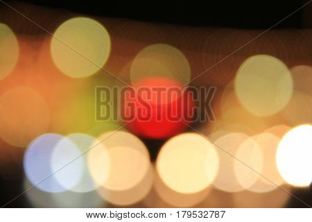 Colorful light blur round bokeh background from festive Christmas night decoration and night life city.