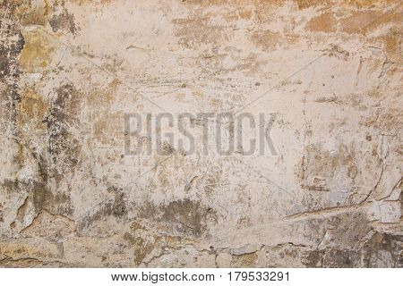 Old grungy wall with damaged plaster abstract horizontal background texture. Graffiti element