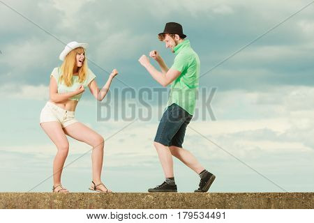 Young Couple In Love Fighting Outdoor