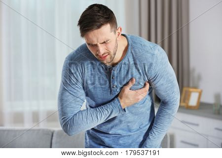Man having a heart attack at home