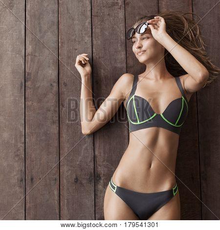 Young slim beautiful woman in bikini. Copyspace for text.