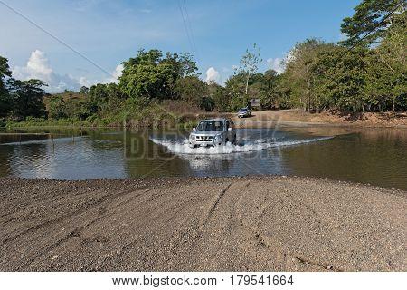 DRAKE, COSTA RICA-MARCH 14, 2017: Car at a river crossing near Drake, Costa Rica