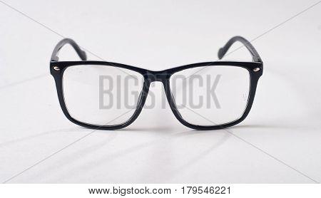 Black Glasses On A White Background,