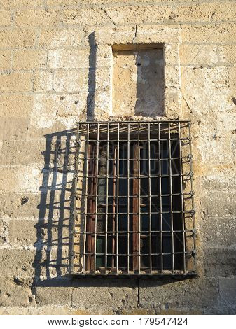 Wrought Iron Grill or bars on Window in church wall in Andalusian village of Alora