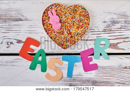 Easter paper lettering on wood. Heart box, bright sprinkle dots.