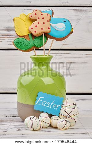 Easter crafts and cookies. Vase and polystyrene eggs.