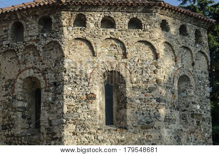 Agliate Brianza (Monza Lombardy Italy): exterior of the medieval church of Saints Peter and Paul built from the 11th century: baptistery