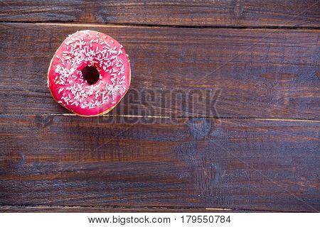 Photo Of Tasty Glazed Donut On The Wonderful Brown Wooden Background
