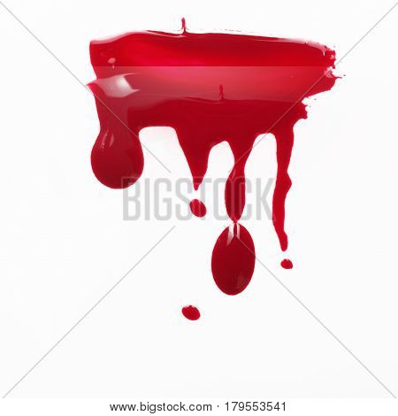 Cosmetics and beauty. Delicious and extravagant red nail polish drips isolated on white background. Creative art, modern abstractionism, painting.