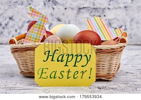 Easter basket, yellow greeting card. Colorful paper cutouts and eggs.