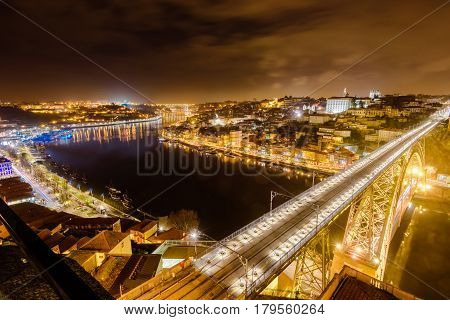 Dom Luis I bridge over Douro river illuminated at night, Porto, Portugal