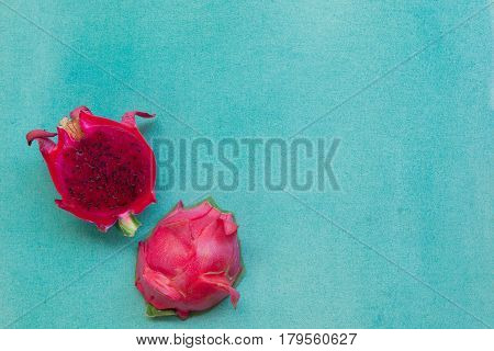 Colorful Minimalistic Still Life Of Two Halves Red Dragon Fruit On A Bright Blue Textured Background