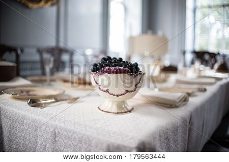 Dishes and Silverware and Fruit Bowel on Dinner Table
