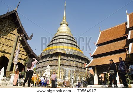 Asian Thai People And Foreigner People Respect Praying And Walk Visit Chedi At Wat Phra That Lampang