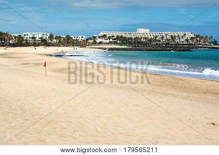 Golden sands and blue sea Playa de las Cucharas beach in Costa Teguise Lanzarote Spain view of the beach and sea selective focus