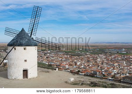 A hill with old white windmill at a viewpoint near Consuegra (Castilla La Mancha Spain) a symbol of region and journeys of Don Quixote (Alonso Quijano).