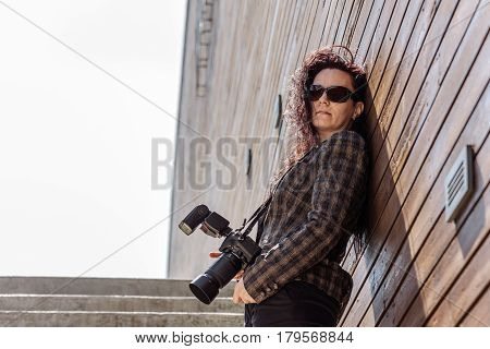 Photographer lady who in this case is a model for other photographers stairs, close-up