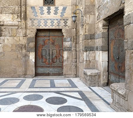 Two perpendicular aged doors of Sultan Barquq mosque. Old Cairo, Egypt