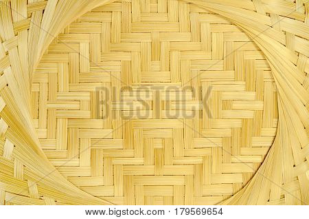 texture frontal view of the bottom of a wicker basket material strips straw light yellow color