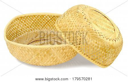 two wicker baskets from the material of the straw light yellow color small basket lies on big basket isolated on white background