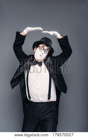 Male mime actor fun mimic performing