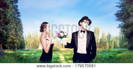 Mime actors performing with flower bouquet