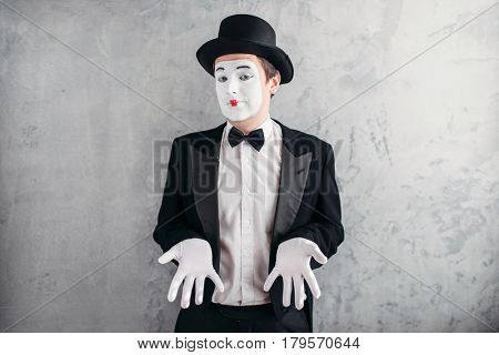 Funny male mime artist with makeup