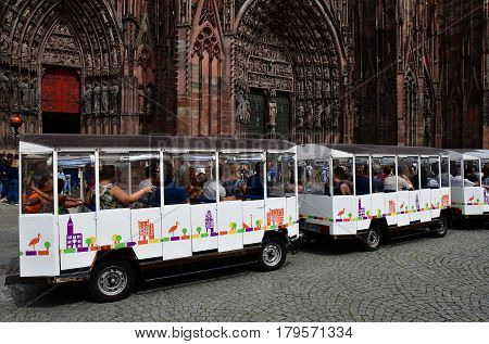 Strasbourg France - july 22 2016 : touristy train behind the Notre Dame cathedral