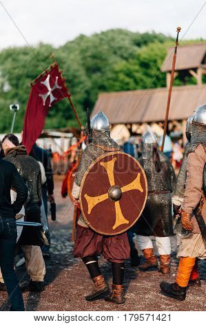 historical costume with chain mail shield armor