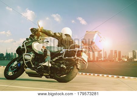 man riding touring motorcycle on sharp curve for traveling and city lifestyle
