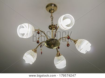 Five-way gilded chandelier with glass shades round