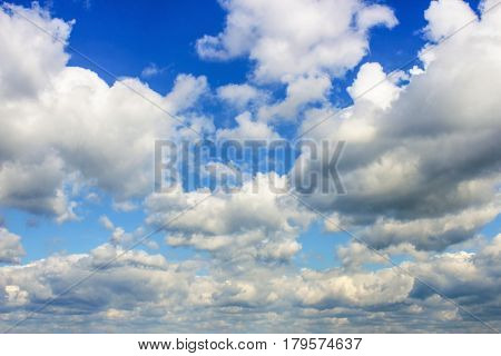 Big clouds on blue sky as background