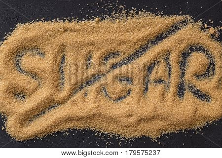 No sugar concept. Brown sugar word on dark background.