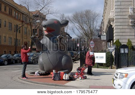 Inflatable Rat and Picketers striking protest outside of building in Chicago, 3-19-2017