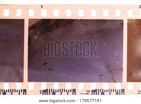 Strip of old worn and bad developed color celluloid film isolated on white background